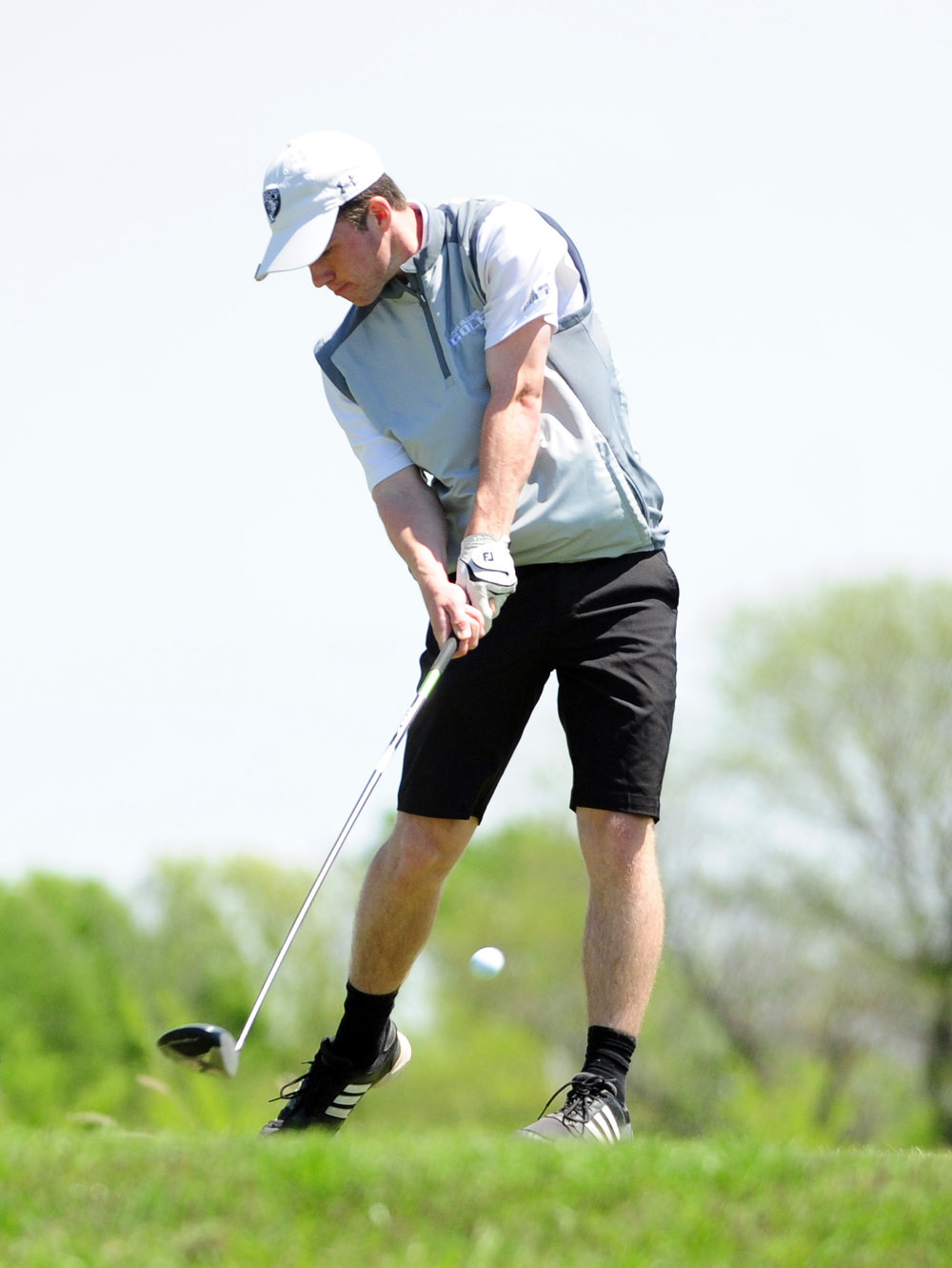 NICK INGRAM/Citizen photo Park Hill South's Zach Bischler hits a tee shot during the  Suburban Conference Red Division Championships held Monday, April 24 at Paradise Pointe Golf Complex in Smithville, Mo.
