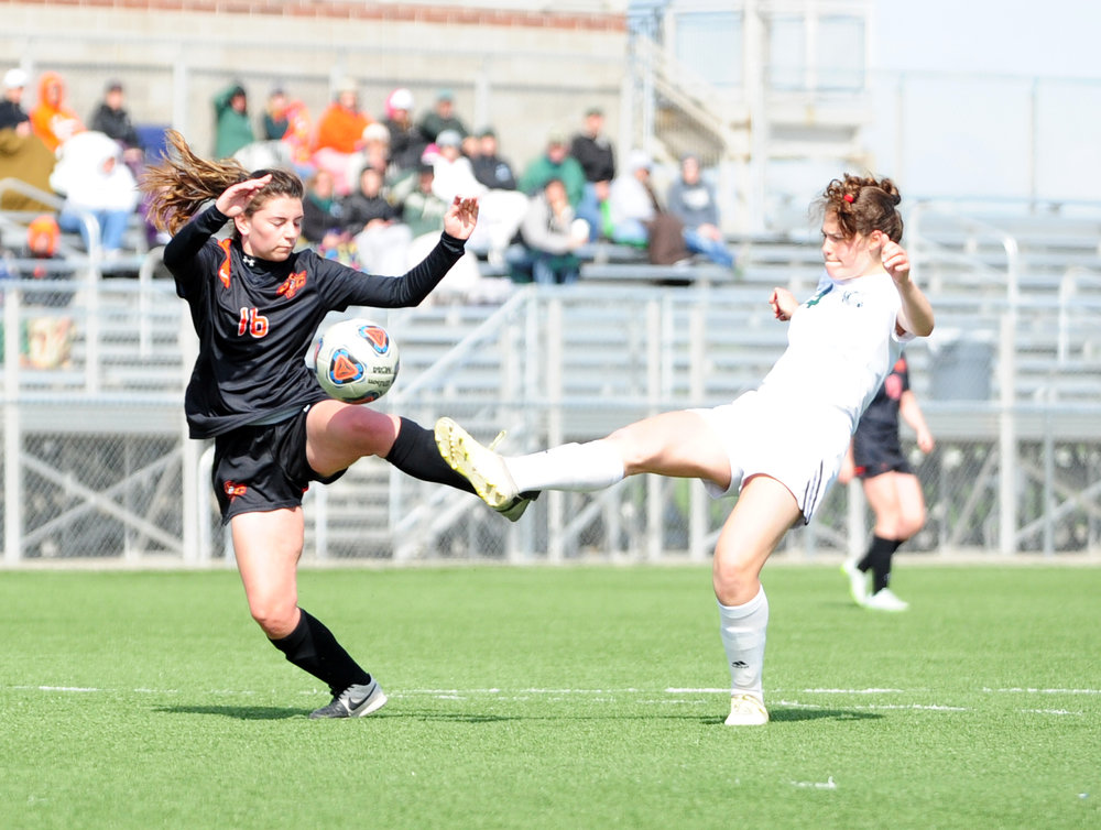 NICK INGRAM/Citizen photo Platte County freshmen midfielder Coryn Stephenson, left, battles for a loose ball against Maryville in the seventh-place game of Oak Park-NKC Invitational on Saturday, April 22 at North Kansas City District Activities Complex in Kansas City, Mo.