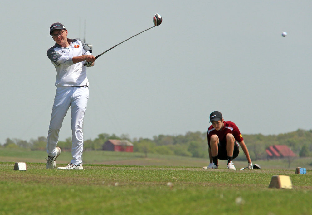 ROSS MARTIN/Citizen photo Platte County senior Tanner Burkin watches his tee shot on No. 10 in the Suburban Conference Blue Division Championships held Monday, April 24 at Shiloh Springs Golf Course in Platte City.