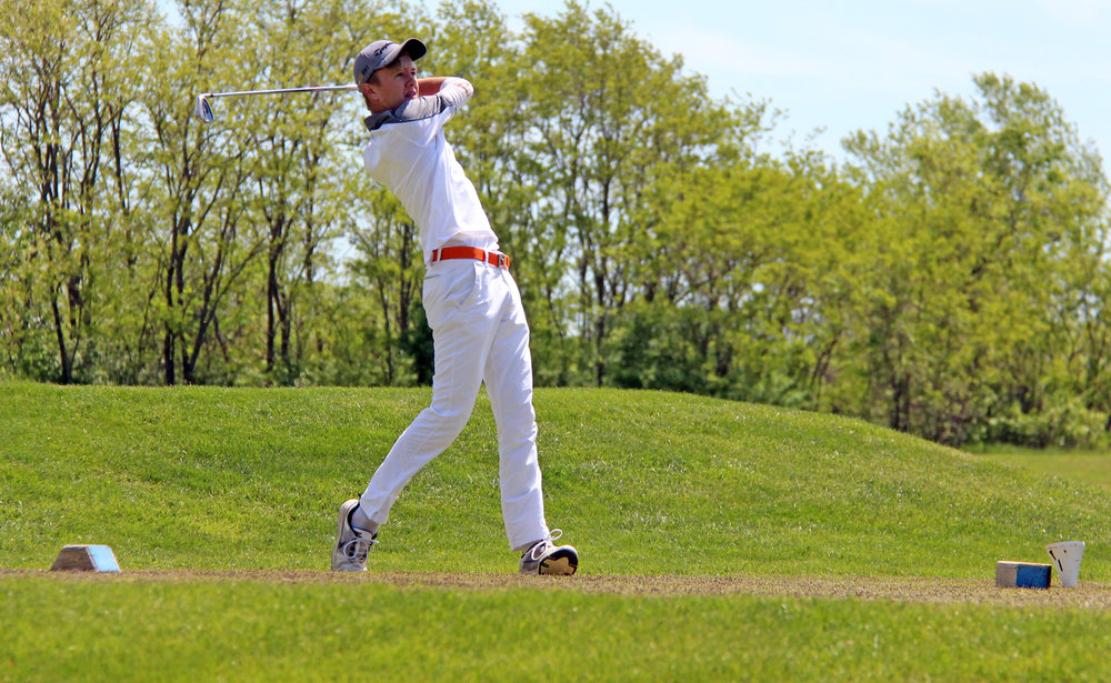 ROSS MARTIN/Citizen photo Platte County senior Payton Boekhout watches his tee shot on No. 18 in the Suburban Conference Blue Division Championships held Monday, April 24 at Shiloh Springs Golf Course in Platte City.