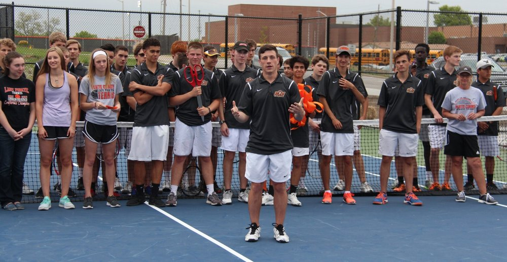 ROSS MARTIN/Citizen photo Platte County senior Spencer Kunz, front, addresses the crowd after the Pirates officially opened a new eight-court tennis facility on campus before a dual with Belton on Tuesday, April 25.