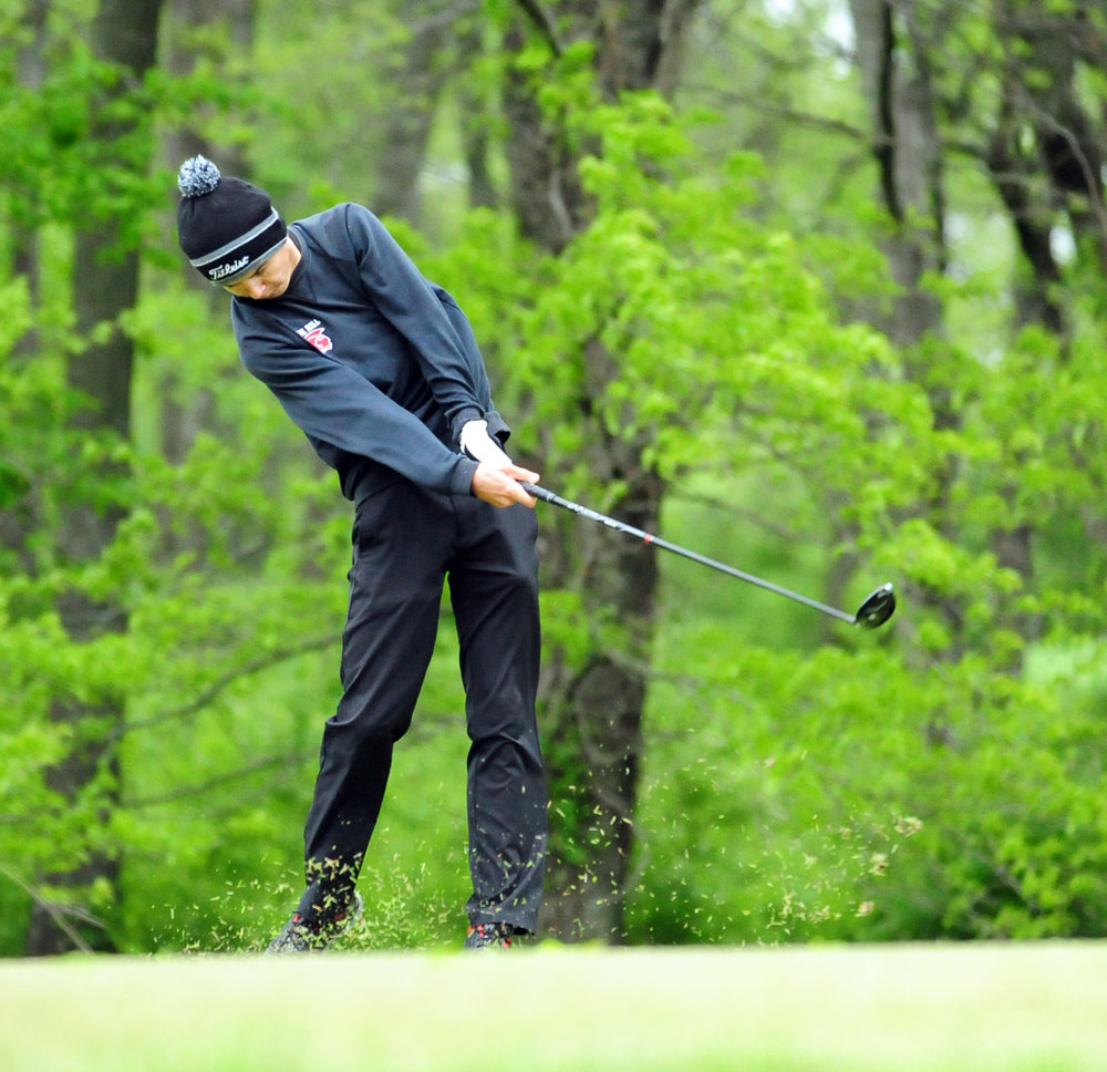 NICK INGRAM/Citizen photo Park Hill senior Kris Snodgrass hits a tee shot during the Class 4 District 8 tournament Monday, May 1 at Shoal Creek Golf Course in Liberty, Mo.