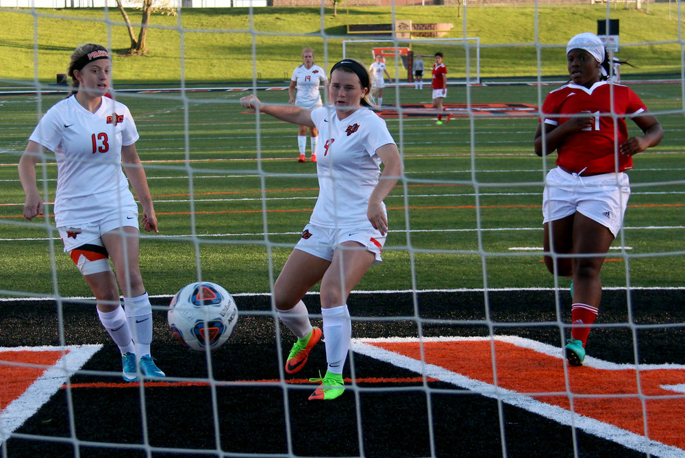 ROSS MARTIN/Citizen photo Platte County senior midfielder Kianna Castro (center) pokes home her third and final goal during an 8-0 win over Raytown South on Monday, May 1 at Pirate Stadium. At left, Platte County junior Kaylyn Hathaway watches the shot go in.