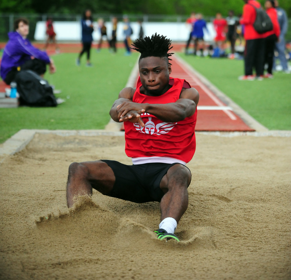 NICK INGRAM/Citizen photo Park Hill senior Papay Glaywulu hits the sand during the triple jump competition in the Gary Parker Invitational on Friday, April 28 in Blue Springs, Mo.