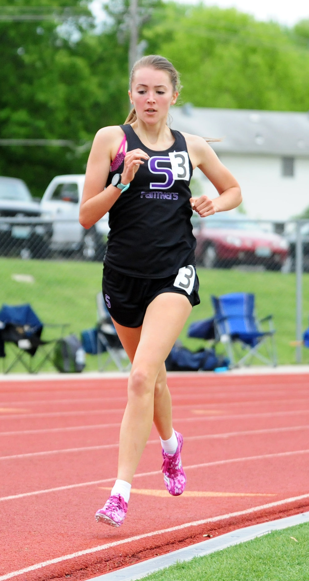 NICK INGRAM/Citizen photo Park Hill South junior Emma Roth runs a curve in the 1,600 on the way to a school record time.