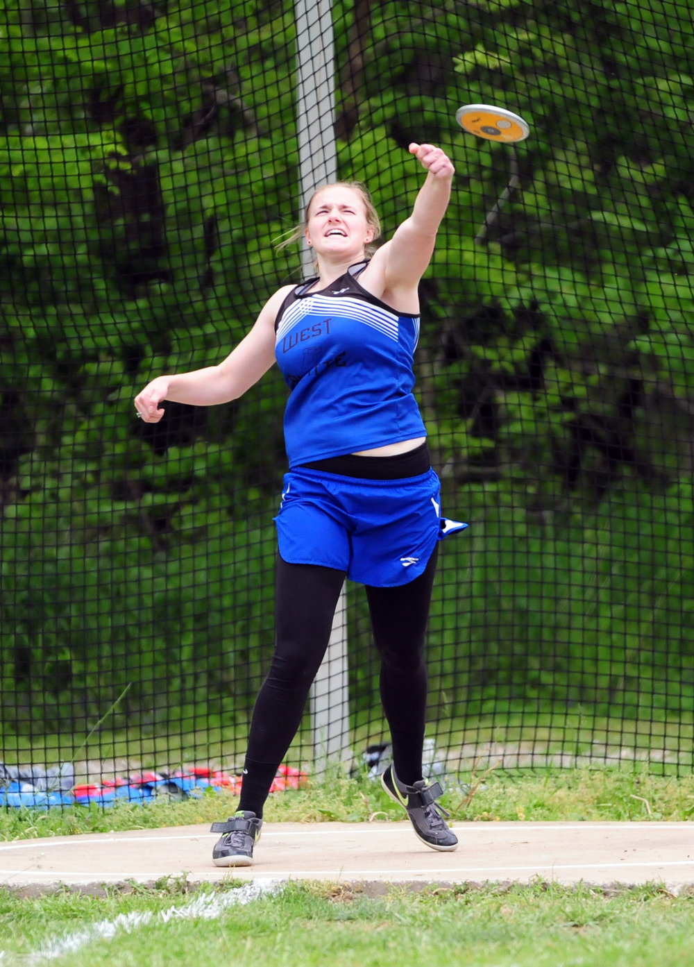 NICK INGRAM/Citizen photo West Platte junior Sydney Oberdiek throws the discus during the KCI Conference Championships held Tuesday, May 2 at Rudolph Eskridge Stadium in Weston, Mo.