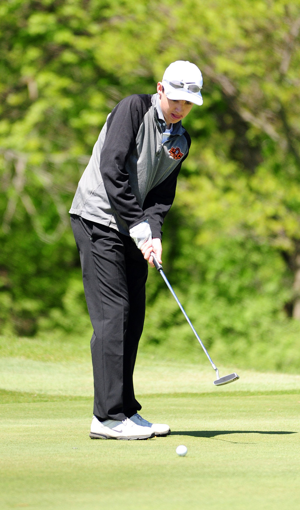 NICK INGRAM/Citizen photo Platte County freshman Logan Hessemyer watches a putt during his round in the Class 3 District 8 tournament Tuesday, May 2 on the Posse Course at Paradise Pointe Golf Complex in Smithville, Mo.