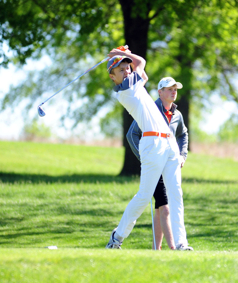 NICK INGRAM/Citizen photo Platte County senior Payton Boekhout watches a tee shot during his round in the Class 3 District 8 tournament Tuesday, May 2 on the Posse Course at Paradise Pointe Golf Complex in Smithville, Mo.