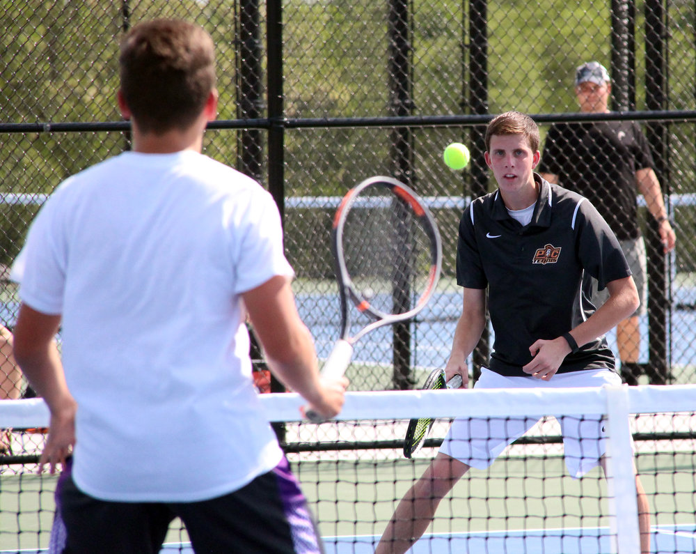 ROSS MARTIN/Citizen photo Platte County junior Spencer Klopfer watches a return shot during a doubles match in a Class 2 District 16 semifinal with North Kansas City on Tuesday, May 9.