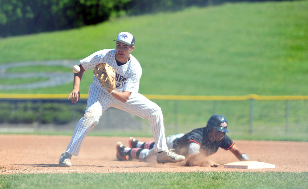 NICK INGRAM/Citizen photo Platte County outfielder Kobe Cummings slides back into first base as Park Hill South's Stephen Personelli takes a throw during  a game Saturday, May 6 at Park Hill South High School in Riverside, Mo.