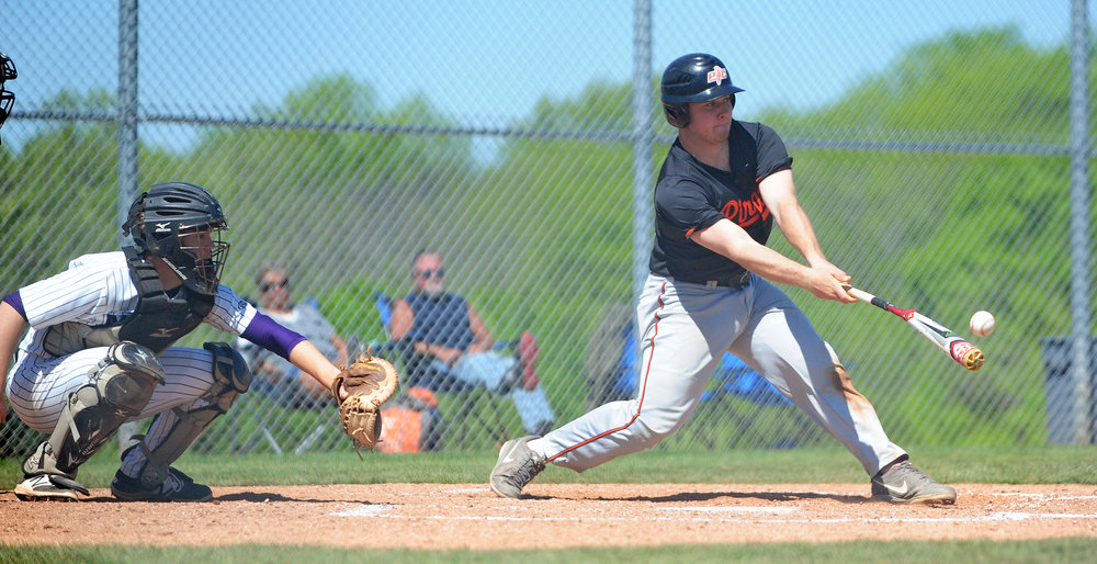 NICK INGRAM/Citizen photo Platte County senior catcher hits a ball against Park Hill South on Saturday, May 6 at Park Hill South High School in Riverside, Mo.