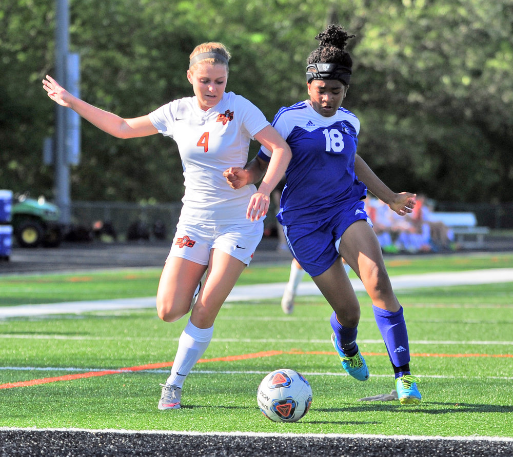 NICK INGRAM/Citizen photo Platte County junior midfielder Hanna Hall battles a Raytown defender for the ball while driving toward goal Monday, May 8 at Pirate Stadium.