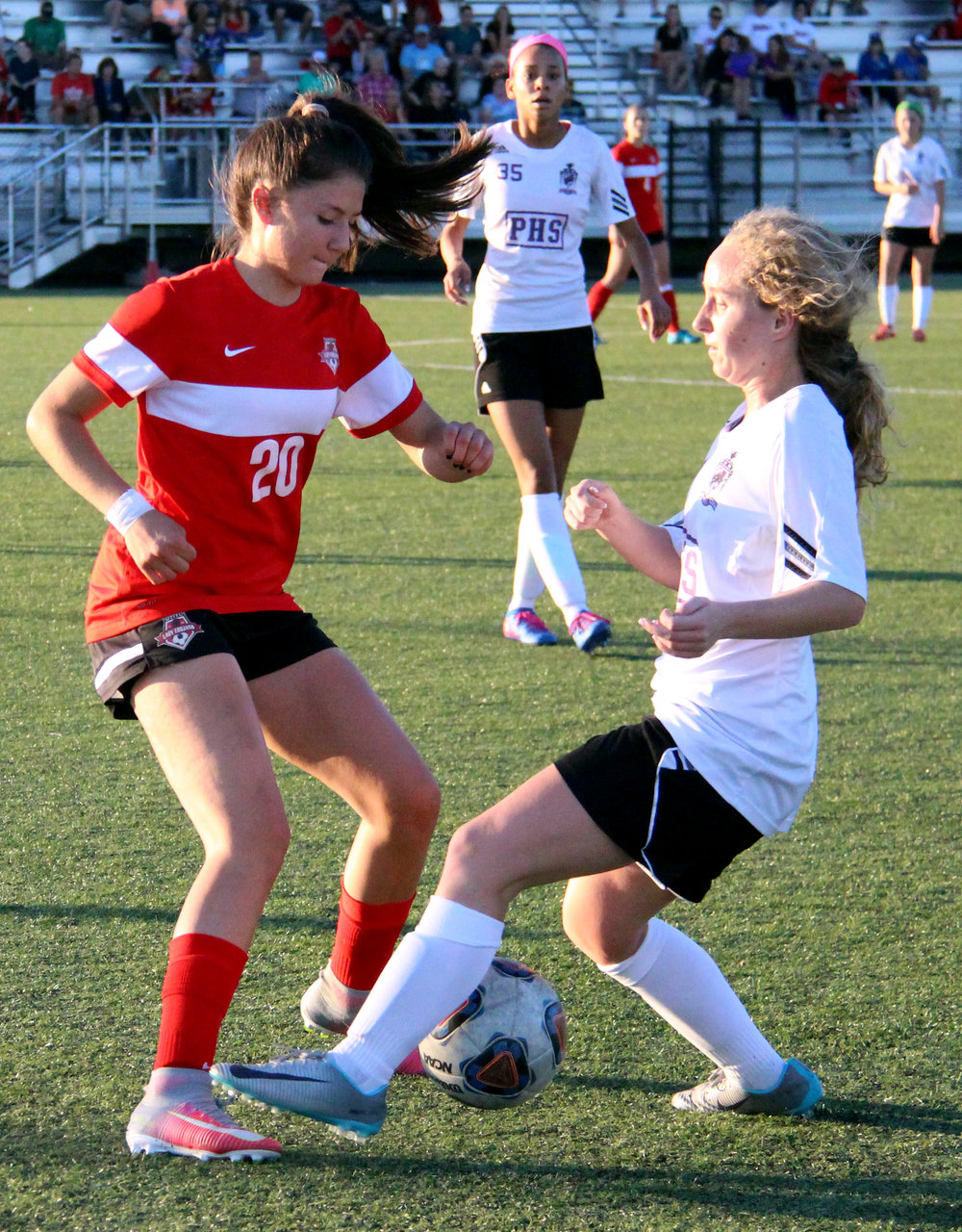 ROSS MARTIN/Citizen photo Park Hill freshman Dragana Andonovski, left, battles for a loose ball against a Park Hill South defender Saturday, May 6 at Park Hill District Soccer Complex in Riverside, Mo.