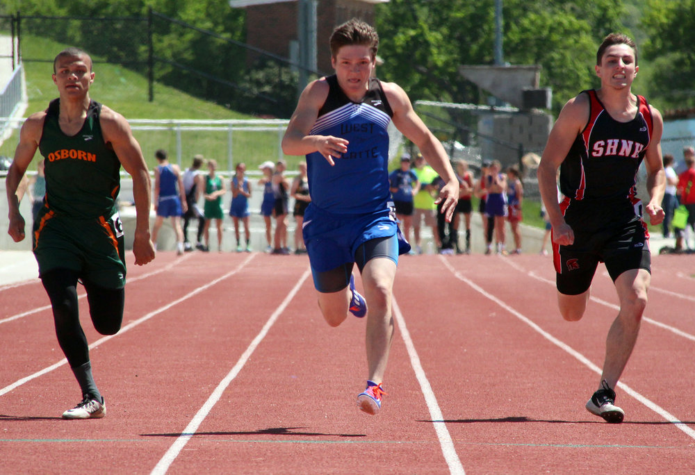 ROSS MARTIN/Citizen photo West Platte senior Rylee Crockett (center) nears the finish line at the end of the 200-meter run Saturday, May 6 in the Class 1 District 8 track meet held at Rudolph Eskridge Stadium in Weston, Mo.