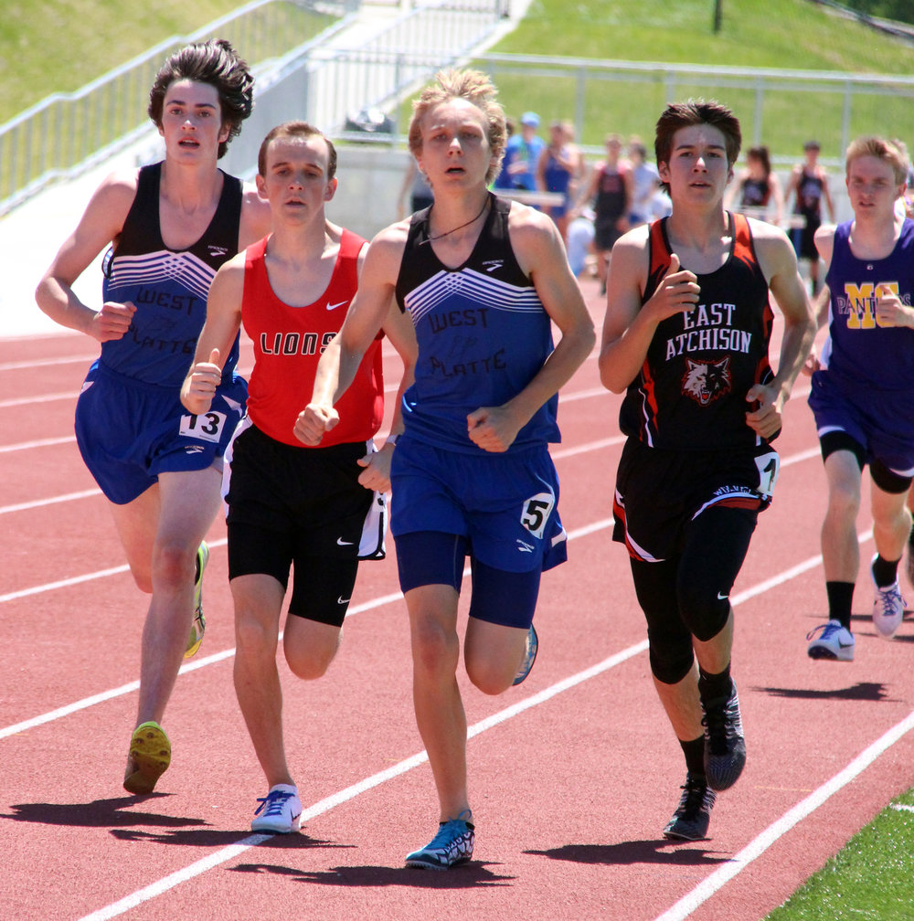 ROSS MARTIN/Citizen photo West Platte sophomore Max Davies (center) leads the pack in the 1,600 with junior teammate Andrew Cicha at the far left.
