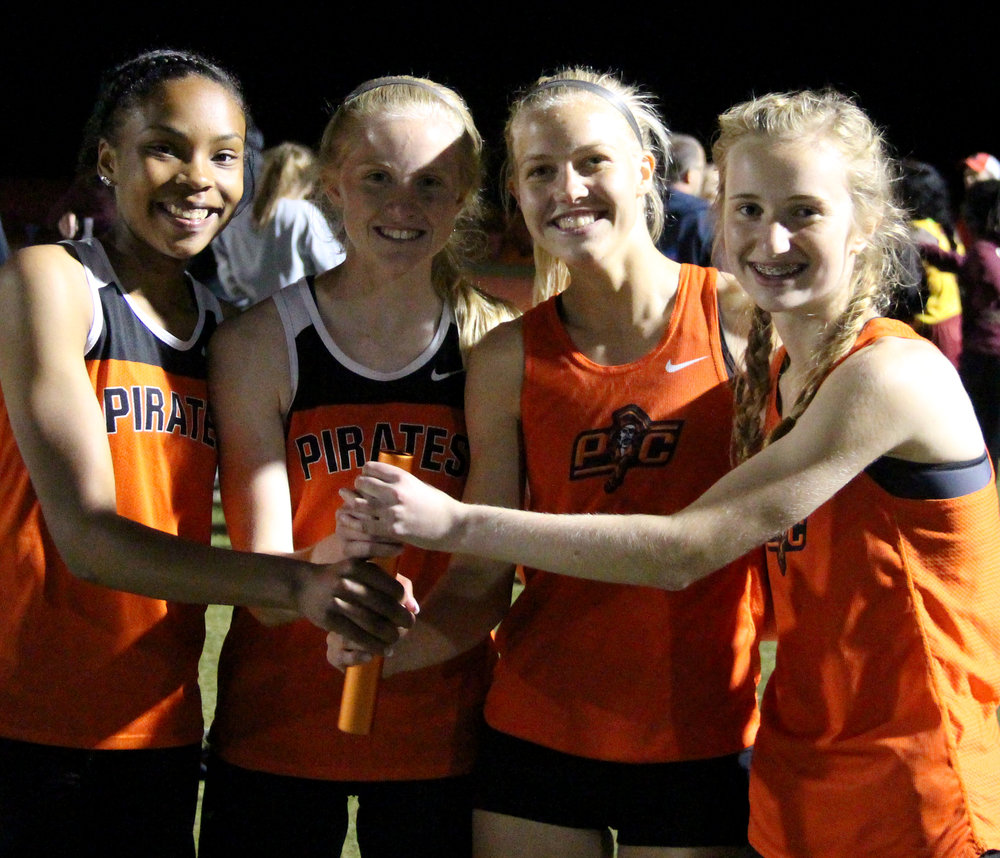 ROSS MARTIN/Citizen photo Platte County runners (from left) Keyondra Butler, Isabelle Geddes, Rebekah Geddes and Jessica Clark set the 4x400-meter relay school record during the Suburban Conference Blue Division Championships on Friday, May 5 in Belton, Mo.