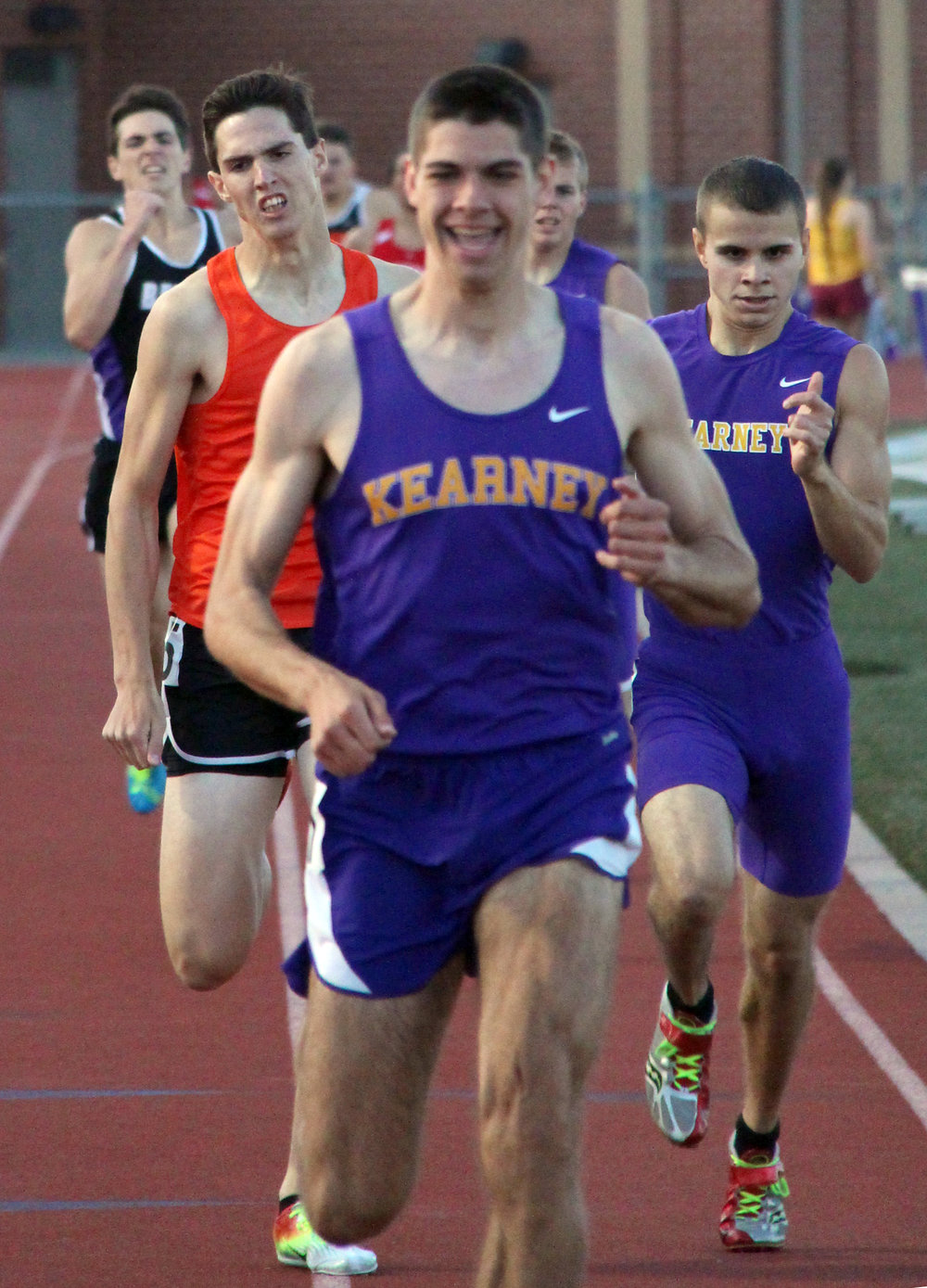 ROSS MARTIN/Citizen photo Platte County sophomore Keegan Cordova, left, fights to finish second in the 800-meter run to Kearney's Clayton Adams (front) during the Suburban Conference Blue Division Championships on Friday, May 5 in Belton, Mo.