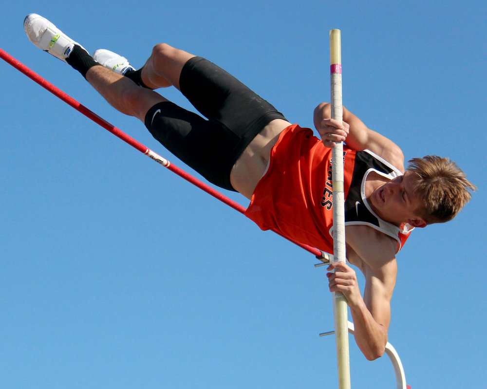 ROSS MARTIN/Citizen photo Platte County junior Jacob Laures clears 13 feet, 9 inches in the pole vault to set a new personal best during the Suburban Conference Blue Division Championships on Friday, May 5 in Belton, Mo.