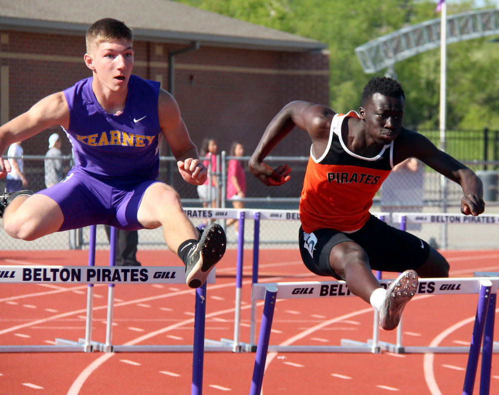 ROSS MARTIN/Citizen photo Platte County senior Okwar Jale hits a hurdle during the 110-meter hurdle race in the Suburban Conference Blue Division Championships held Friday, May 5 in Belton, Mo. The Pirates finished second in both the boys and girls team standings. To find out more, see Sports Weekly starting on page B1.