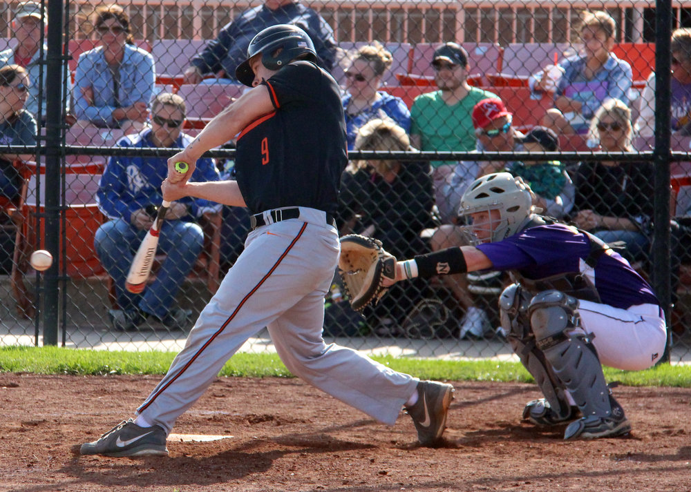 ROSS MARTIN/Citizen photo Platte County senior Justin Mitchell hits a line drive against Kearney on Thursday, May 4 at Platte County High School.