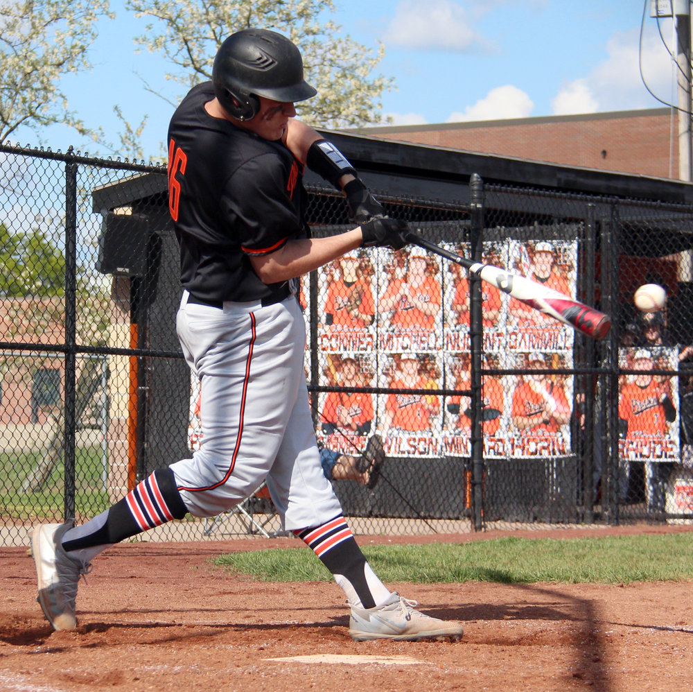ROSS MARTIN/Citizen photo Platte County senior first baseman Austin Gammill makes contact with a pitch in a Suburban Conference Blue Division game with Kearney on Thursday, May 4 at Platte County High School. The Pirates won 3-1 and wrapped up the league title the next day.