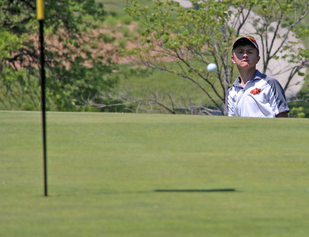 ROSS MARTIN/Citizen photo Platte County senior Payton Boekhout watches a chip shot to the green while he stands in the rough below the hole during the Class 3 Sectional 4 tournament Monday, May 8 at Excelsior Springs Golf Club in Excelsior Springs, Mo.