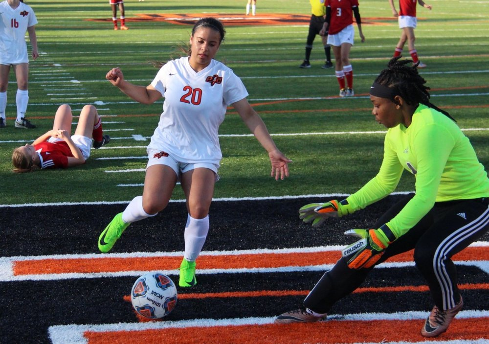 ROSS MARTIN/Citizen photo Platte County junior Destinee Smith (20) left a Raytown South defender in her wake before taking a shot on goal in a game against Raytown South earlier this month at Pirate Stadium.
