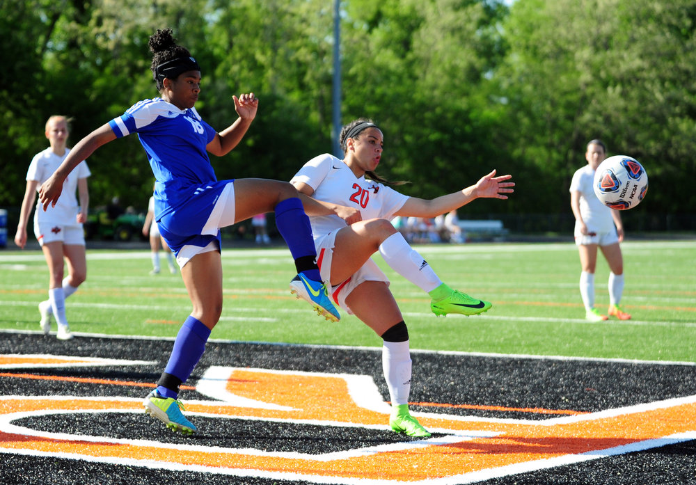 NICK INGRAM/Citizen photo Platte County junior forward Destinee Smith battles with a Raytown defender for a loose ball during a game Monday, May 8 at Pirate Stadium. Smith has been the Pirates leading scorer the past two seasons.