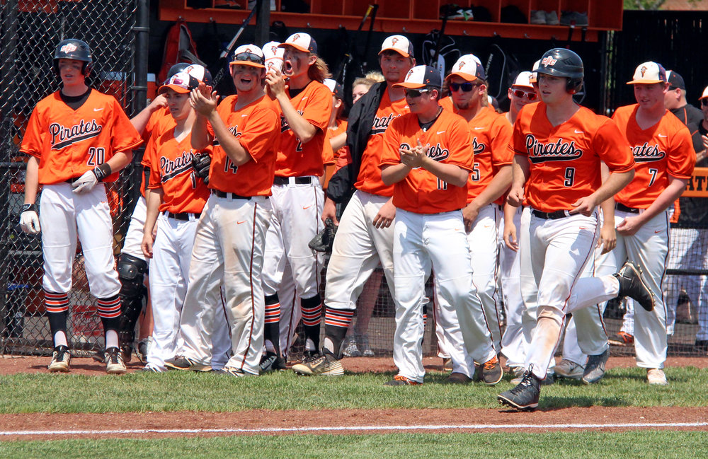 ROSS MARTIN/Citizen photo Platte County senior Justin Mitchell (9) comes toward home plate after hitting a three-run home run in a Class 5 District 16 semifinal against Park Hill South on Monday, May 15 at Platte County High School.