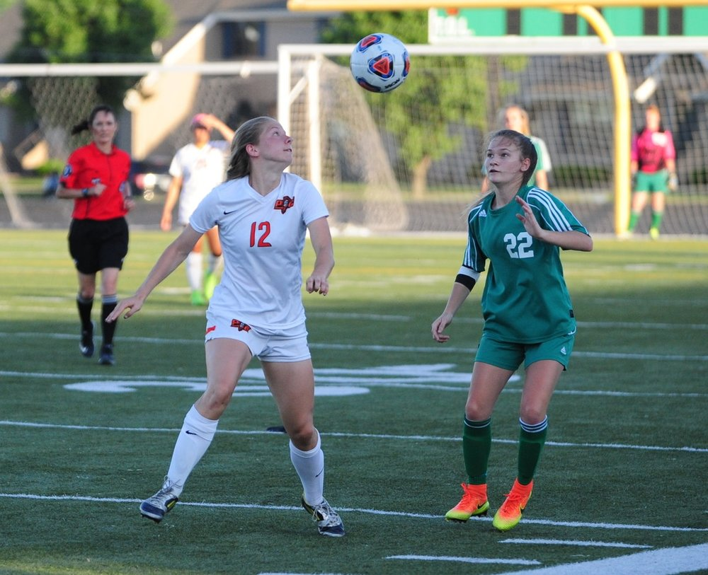 NICK INGRAM/Citizen photo Platte County senior defender Amanda Sullivan, left, looks to clear the ball upfield during a Class 3 District 16 semifinal against Smithville on Monday, May 15 at Smithville High School in Smithville, Mo.