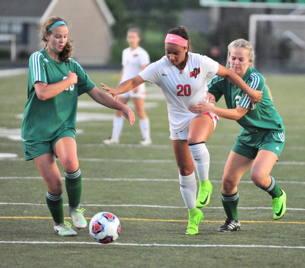 NICK INGRAM/Citizen photo Platte County junior forward Destinee Smith (center) tries to fight through two Smithville defenders during a Class 3 District 16 semifinal Monday, May 15 at Smithville High School School in Smithville, Mo.