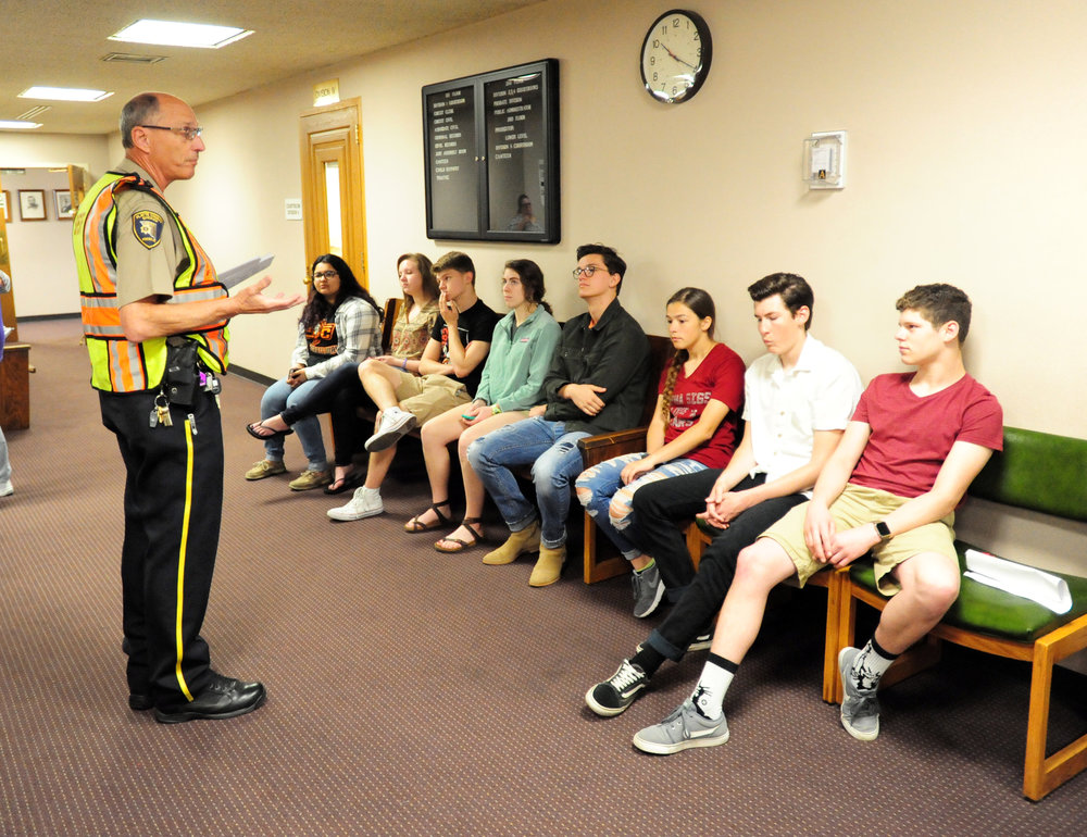 NICK INGRAM/Citizen photo A Platte County Sheriff's Office deputy talks to Platte County R-3 students brought in to help act out scenarios in an active shooter training exercise held Friday, May 12 at the Platte County Courthouse in Platte City.