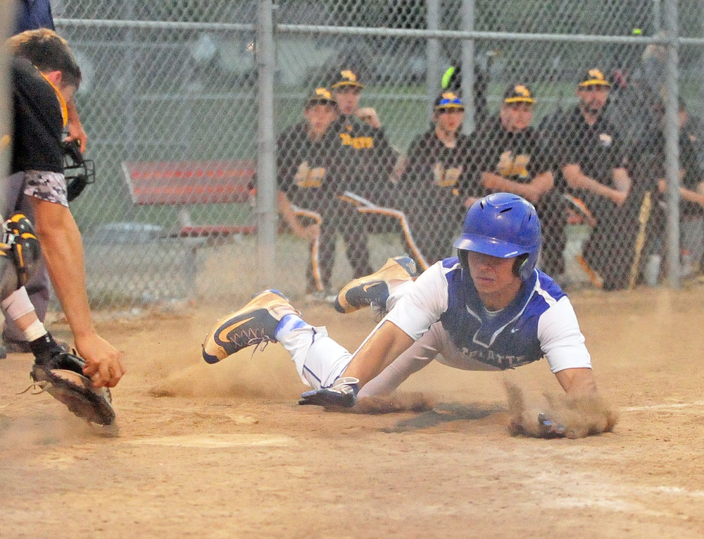 NICK INGRAM/Citizen photo West Platte senior Alec Carson slides safely into home during a Class 2 District 16 first round game against Wellington-Napoleon on Thursday, May 11 in Concordia, Mo.