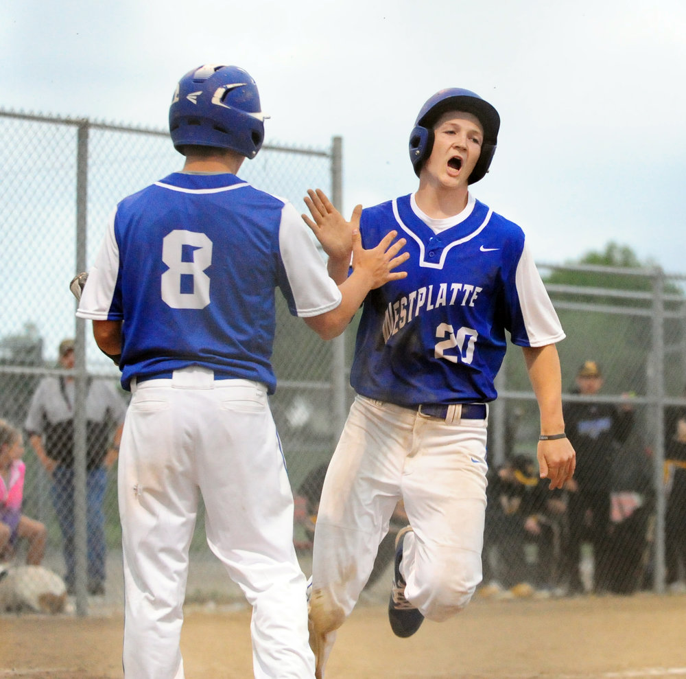 NICK INGRAM/Citizen photo West Platte sophomore Noah Johnson (20) celebrates a run scored.