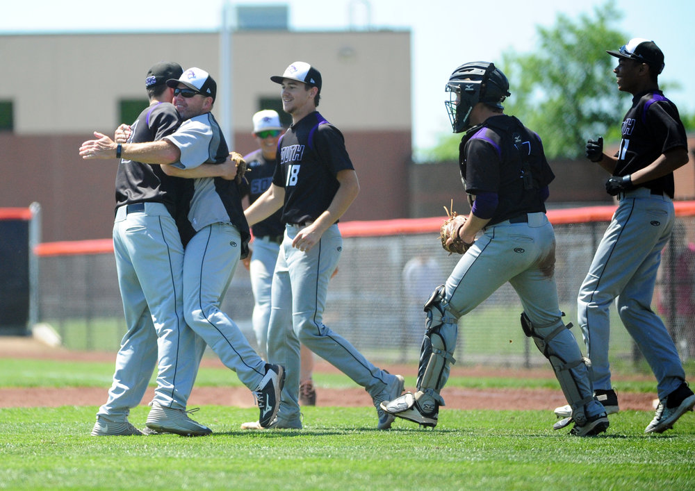 NICK INGRAM/Citizen photo Park Hill South players and coaches celebrate a 2-1 win over Park Hill in a Class 5 District 16 first round game Saturday, May 13 at Platte County High School.