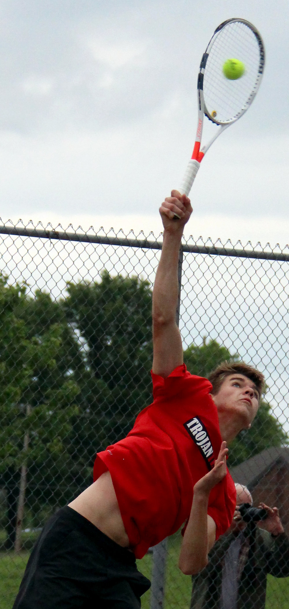 ROSS MARTIN/Citizen photo Park Hill sophomore Cooper Hayes hits a serve during the Class 2 District 16 championship dual with North Kansas City on Thursday, April 11 at Barry Park in Kansas City, Mo.