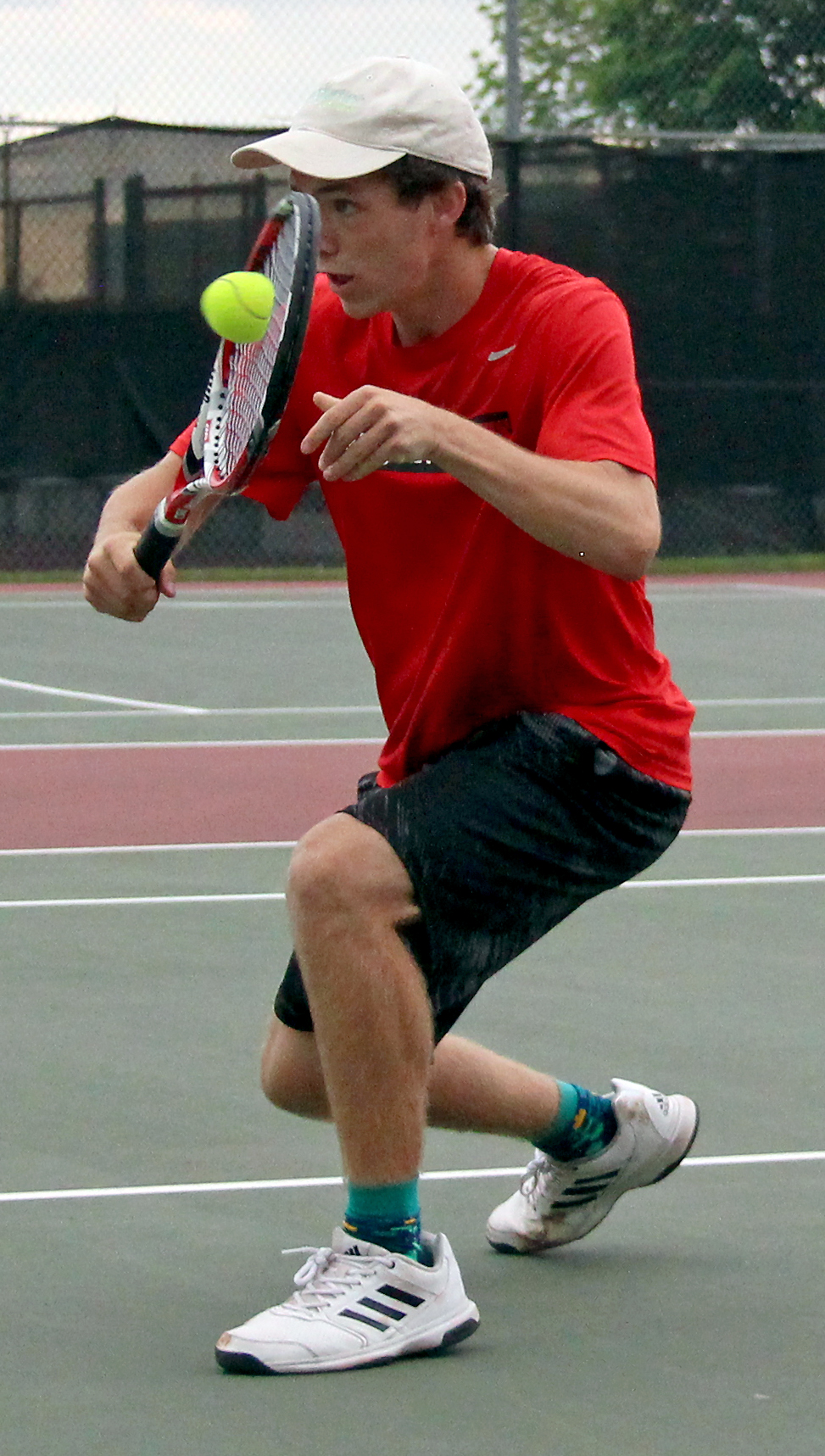 ROSS MARTIN/Citizen photo Park Hill senior Grant Martin hits a backhand volley during a doubles match in the Class 2 District 16 championship match Thursday, May 11 at Barry Park in Kansas City, Mo.