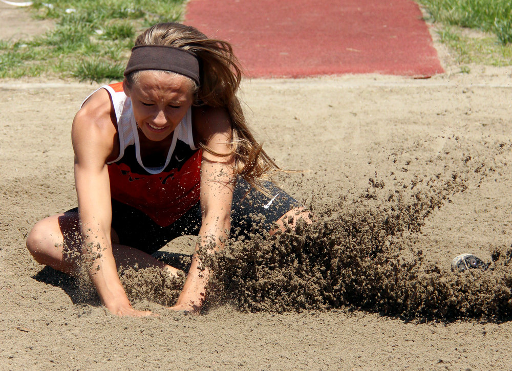 ROSS MARTIN/Citizen photo Platte County senior Tori Farr hits the sand during the long jump competition in the Class 4 District 8 meet Saturday, May 13 at Park Hill District Stadium in Kansas City, Mo.