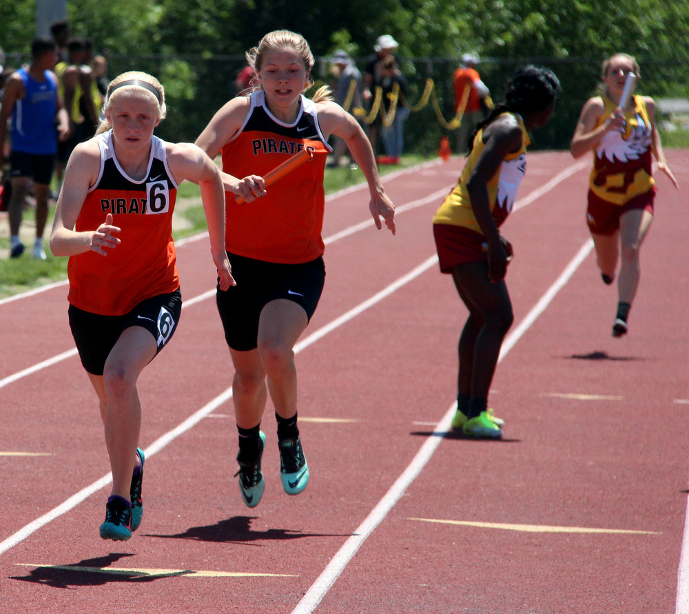ROSS MARTIN/Citizen photo Platte County senior Amanda Sullivan, rear, prepares to handoff to freshman Isabelle Geddes during the 4x200-meter relay Saturday, May 13 at Park Hill District Stadium in Kansas City, Mo. during the Class 4 District 8 meet.