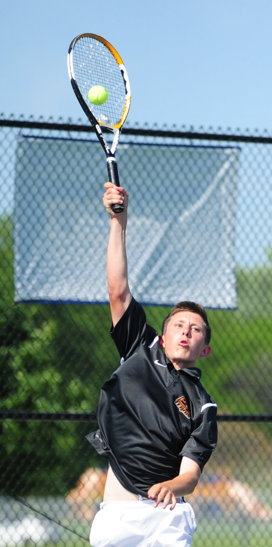 NICK INGRAM/Citizen photo Platte County junior Noah Singer hits a serve during a Class 2 Sectional 8 singles match against Staley's Carson Gates on Monday, May 15 in Kearney, Mo.