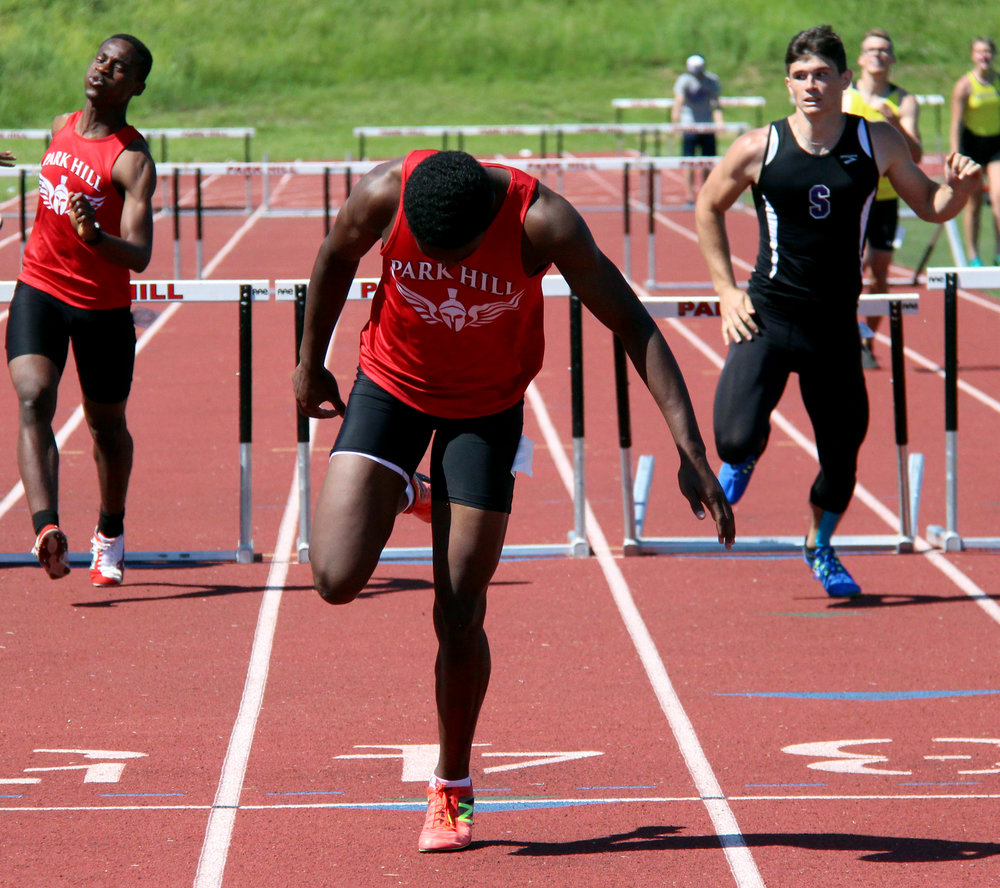 ROSS MARTIN/Citizen photo Park Hill senior Grant Downes, center, crosses the finish line to win the 300-meter hurdles race  during the Class 5 District 8 meet Saturday, May 13 at Park Hill District Stadium in Kansas City, Mo. At left is teammate Al-Ameen Agunbiade while Park Hill South's Grant Hudson is at right.