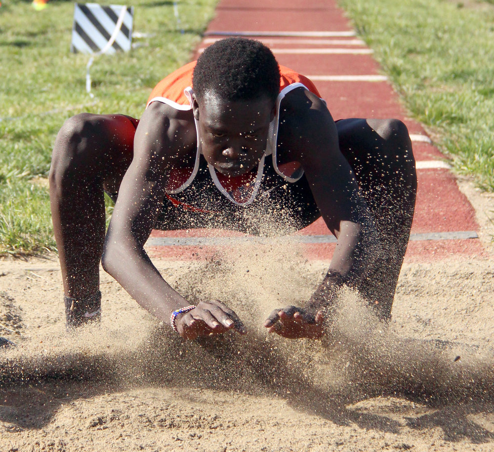 ROSS MARTIN/Citizen photo Platte County senior Mac Leet hits the sand in the triple jump during the Class 4 District 8 championship plaque Saturday, May 13,