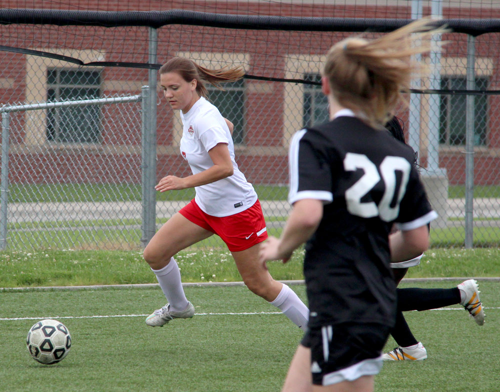 ROSS MARTIN/Citizen photo Park Hill senior Meg Feeley (left) looks to make a clearance in the Class 4 District 16 championship game Thursday, May 18 against Staley at North Kansas City District Activities Complex in Kansas City, Mo.