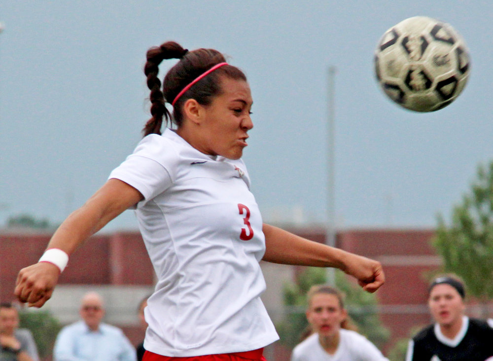 ROSS MARTIN/Citizen photo Park Hill junior Chais Wright heads the ball upfield during the Class 4 District 16 championship game against Staley on Thursday, May 18 at North Kansas City District Activities Complex in Kansas City, Mo.