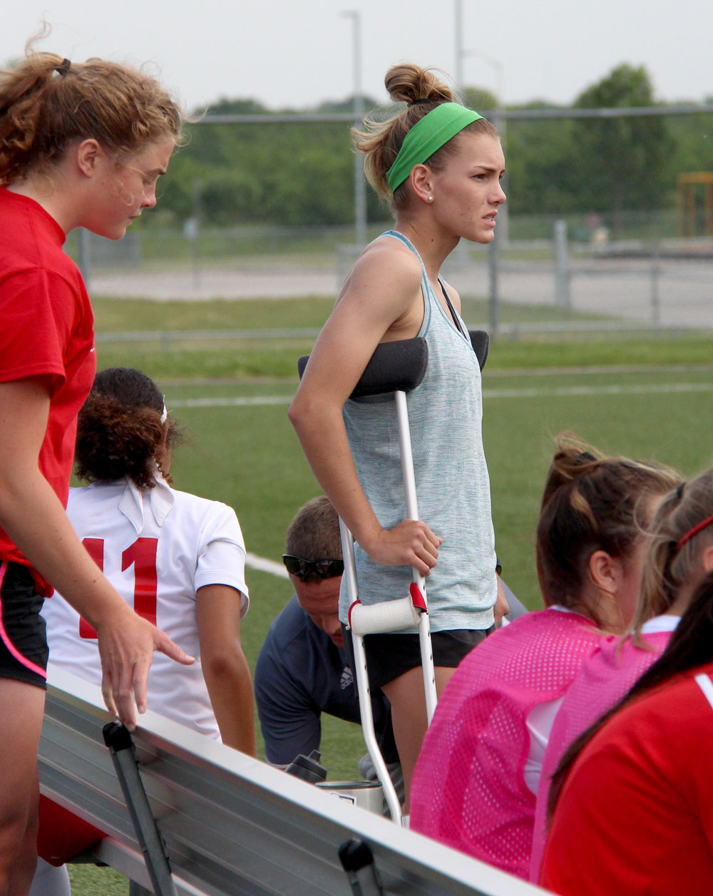 ROSS MARTIN/Citizen photo Park Hill senior Jenna Winebrenner watched the Class 4 District 16 championship game from the bench Thursday, May 18 at North Kansas City District Activities Complex in Kansas City, Mo. She suffered a season-ending leg injury 10 days earlier.