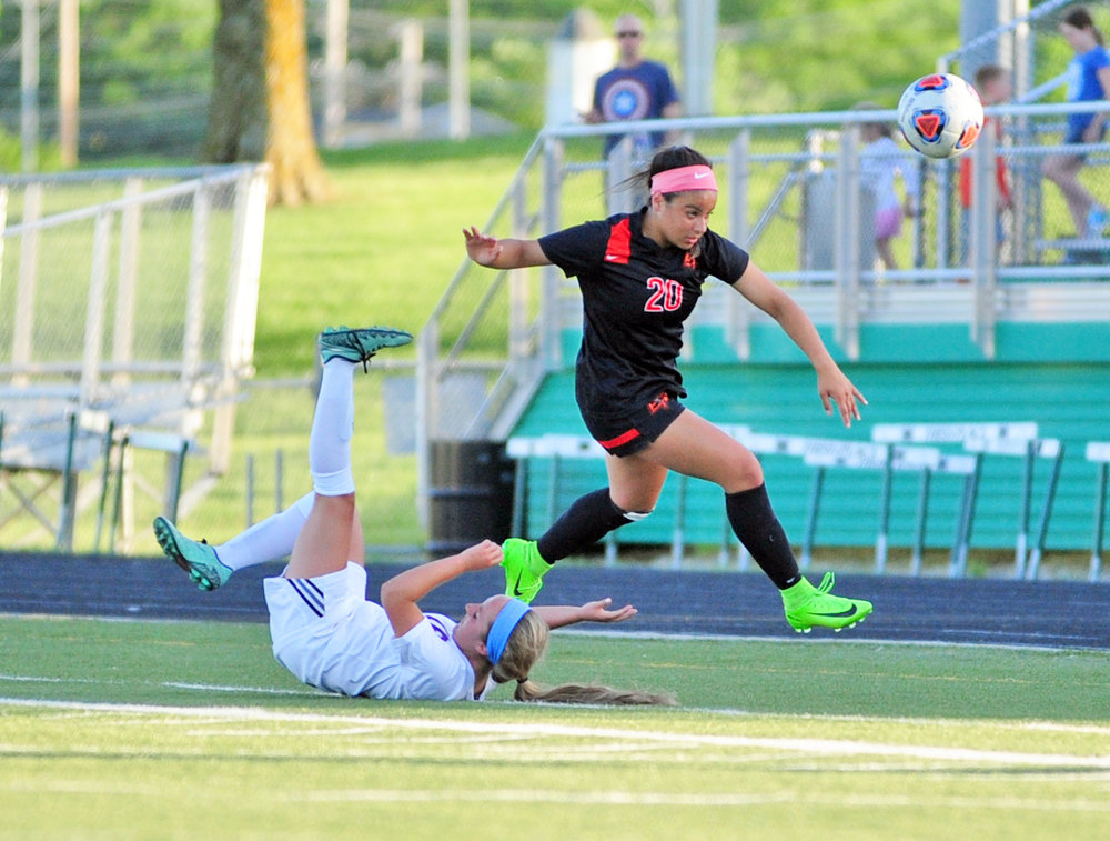 NICK INGRAM/Citizen photo Platte County junior forward Destinee Smith (20) runs over a defender in search of the ball in the Class 3 District 16 championship game Wednesday, May 17.