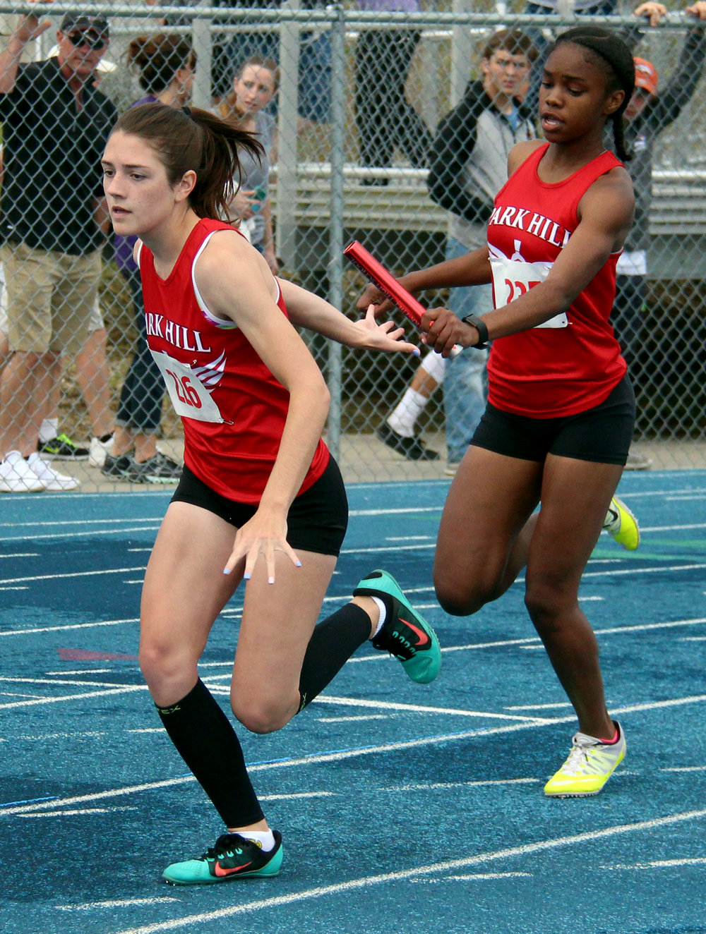 ROSS MARTIN/Citizen photo Park Hill junior Taiya Shelby, right, hands the baton to junior Jena Hahlbeck during the Class 5 Sectional 4 4x200-meter relay Saturday, May 20 at Blue Springs South High School in Blue Springs, Mo.