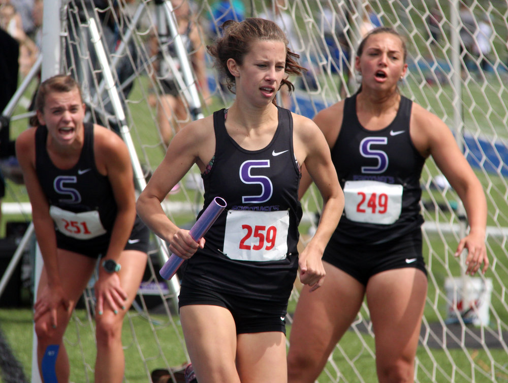 ROSS MARTIN/Citizen photo Park Hill South senior Lexi Maddox, center, runs her leg of the Class 5 Sectional 4 4x800-meter relay Saturday, May 20 at Blue Springs South High School in Blue Springs, Mo. with senior Jasmine Crawford, left, and junior Justine Aiello supporting her.