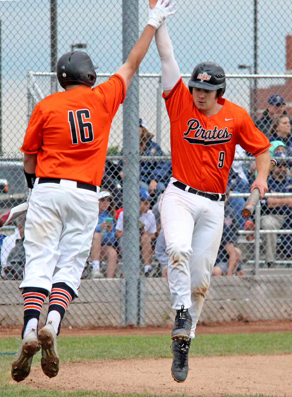 ROSS MARTIN/Citizen Editor Platte County seniors Justin Mitchell, right, and Austin Gammill celebrate Mitchell's first inning run in a Class 5 sectional against Liberty North on Tuesday, May 23 in Liberty, Mo.