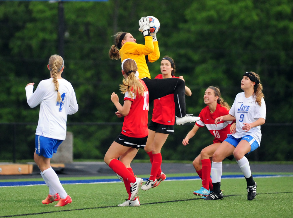 NICK INGRAM/Citizen photo Park Hill junior goalkeeper Kelbey Emerson (yellow shirt) goes high to make a save in a Class 4 sectional against Liberty on Tuesday, May 23 in Liberty, Mo.